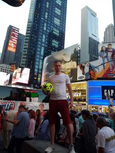 artist roy munday in times square, new york, with son andrew