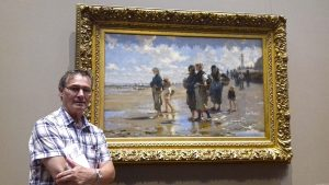 roy munday, artist, painting trip to New York, stood in front of painting by john singer sergeant