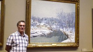 artist, roy munday, in front of edward willis redhead's painting in washington, usa